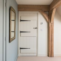 painted softwood ledge and boarded door with ironmongery and matching painted architrave and skirting