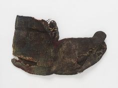 50-220 CE.  Before the technique of knitting with two needles evolved, textiles with a very similar structure and texture were created by a technique known as 'single-needle knitting'. This sock, made in this method, was intended to be worn with sandals, as the big toe is shaped separately from the other toes. It was excavated from Christian burial grounds of the late Roman period, found in the present-day city of al-Bahnasa in Egypt.