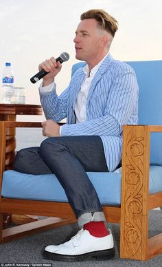 Trendy: Ewan, 44, donned a colourful outfit to match, wearing a blue pinstriped blazer and...
