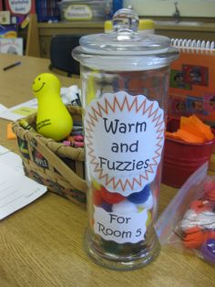 """When the class receives a compliment, toss a """"Warm and Fuzzy"""" in the jar.  Set a goal, and celebrate when you reach it!"""