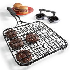 I want to get one of these burger/hot dog/fish grill holders. I love the flavor of campfire in my meat. this would allow us to make a few burgers at a time so we are all eating together. Love this.