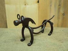 Resultado de imagem para art made with horseshoes