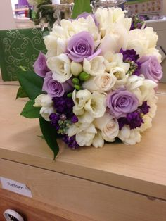 Purple and whites bridal bouquet