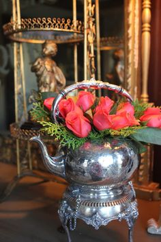 Beautiful roses in an antique tea pot via Romancing the Home