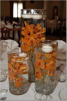 Submerged orange orchids