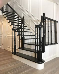 The contrast between the light hardwood floors and pure white walls make the dark black staircase stand out beautifully Stained Staircase, Dark Staircase, Black Stair Railing, Black Stairs, Painted Staircases, Staircase Railings, Staircase Design, Banisters, Stairways