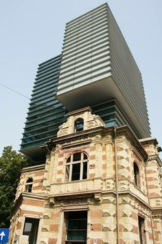 """The headquarters of the Romanian Architects Union, BUCHAREST, 1992-2003  Architects: Dan Marin and Zeno Bogdanescu  The new building incorporates the facade of a house that burned during the 1989 Revolution (kept as a witness of the events, so """"the traces of the history remain intact"""")"""