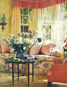 Yellow roses living room. Sunlight in English country Manor. Evening is also spectacular with uplit flower paths.
