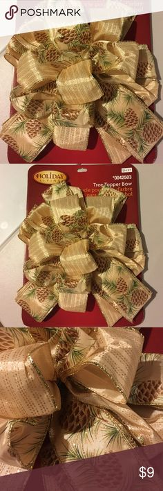 NWT Christmas Bow/ Tree Topper NWT Christmas Bow/Tree Topper Rustic look in Gold, brown pine cones, green pine & gold glitter. Wire for shaping, Large: packaging size is 14.5H x 10.25W Holiday Living Other