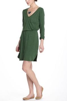 Gold Azza belt adds a little glamour to a slouchy green dress