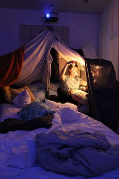 No matter how old you are, blanket forts are probably the best thing you can do with a bunch of sheets, pillows, and string lights.