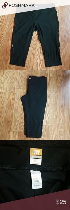 Lucy yoga capris Black capri yoga/running pants by Lucy Tech. Small zipper pocket in back. Draw string. Reflector tape on each leg. Good used condition. Size medium Lucy Pants Ankle & Cropped