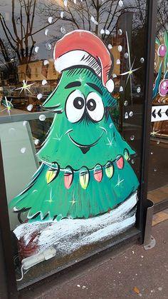 Décoration de vitrines de Noël Les fêtes de Noël approchent ? Profitez de l'occasion pour agrémenter votre vitrine d'une décoration de vitrine peinte à la main aux couleurs de Noël qui attirera à coup sûr les passants.