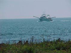 Fishing trawler at Yarmouth light. Nova Scotia. I took this photo in September 2001