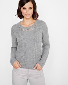 This super cute cashmere-like sweater embellished with embroidered jewels at the neckline is ideal to keep you looking feminine when the temperature drops. Wear it with a pencil skirt or skinny pants for added flair.<br /><br />- Cashmere-like knit<br />- Long sleeve<br />- Round neck