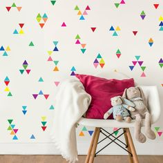 96 wall decals in rainbow bright multi-color peel and stick fabric mini triangle wall decals that are removable and reusable decal stickers. 96 mini triangles per sheet.There are so many ways to arrange these triangles to add a beautiful bright rainbow of colors to your walls! Great for kids rooms, nurseries or apartments as there is no damage to walls! Each triangle measures 2.4 by 2.8 We have the same bright multicolor rainbow in 4 dots: https://www.etsy.com/listing/15...