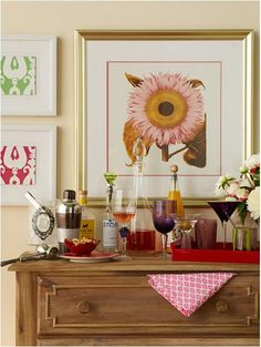 We love unexpected touches like a chest of drawers for a bar ~ keeps linens, serving pieces, coasters all within easy access. Mix shapes & sizes of glassware in the same color scheme. Use wine stoppers in mixer & liquor bottles. Try a trifle bowl as an ice bucket.