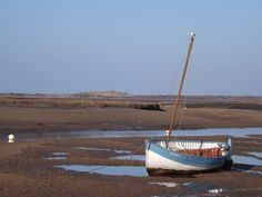 High & Dry, Burnham Overy Staithe looking out to Gun Hill at low tide.