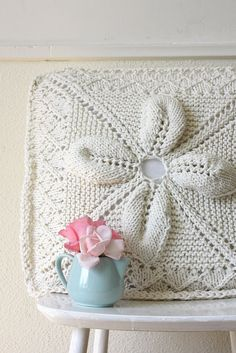 Not crochet.  Knitting.  But again, why I need to learn me some knitting! :)Knitted leaf & lace square by Machteld M on Flickr.