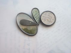 4 shapes brooch; postcards + stamp | by Clare Hillerby