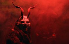A man dressed as a devil performs during a Krampus show in the southern Bohemian town of Kaplice on December 13, 2014. Each year people in traditional costumes and masks parade through the streets to perform an old ritual to disperse the ghosts of winter.