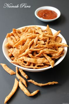 """NAMAK PARE """"Fried Savory Flour Crispies"""". They are made from all purpose flour and carom seeds. Try these salty and crispy snacks at anytime and let me know how do you like it. Yummy! :)  Click on the picture to watch recipe video."""
