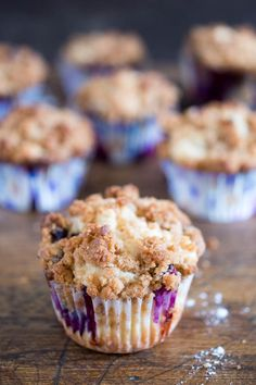 Bakery Style Blueberry Streusel Muffins. Loaded with fresh blueberries and sour cream for extra moist muffins. Perfect start to any morning! | chefsavvy.com #recipe #breakfast