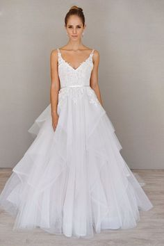 """Style 9605 - Ivory / Cashmere tulle and lace bridal ball gown with a sheer """"V"""" neckline and low ballerina scoop back. Thin satin ribbon at the natural waist and a horsehair edged flounce skirt with shimmer throughout."""