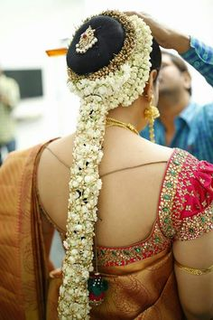 South Indian bride. Gold Indian bridal jewelry.Temple jewelry. Jhumkis.Gold silk kanchipuram sari.Braid with fresh flowers. Tamil bride. Telugu bride. Kannada bride. Hindu bride. Malayalee bride.Kerala bride.South Indian wedding.