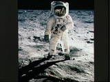 A picture of Buzz Aldrin walking on the Moon, with a reflexion from his helmet.