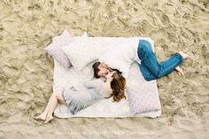 I also forgot this today! A really cute blanket so we could cuddle in the sand!!! santa-monica-beach-engagement-photos-01
