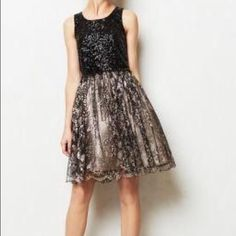 Leifsdottir from Anthropolgie 6 petite sequin lace Great condition, Only worn once in NYE Sequin and lace Leifsdottir  dress from Anthropologie. Waist is 15 inches laying flat and length from Tom to bottom is 29 inches. Anthropologie Dresses Midi