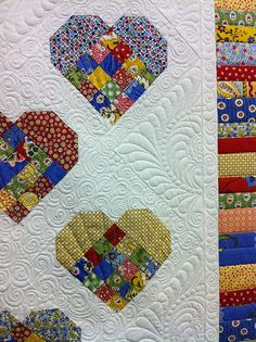patchwork heart quilt, elaborate feathered quilting