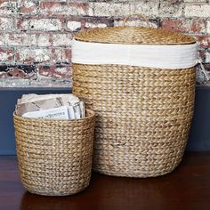 Tall Curved Basket - 20 w x 24 h - $129 - Like that we could wash the lining with the clothes;)