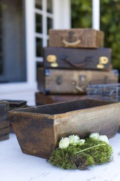 Vintage suitcases are terrific props for your wedding reception..check local flea markets, antique stores or thrift store locations. Could use as a card box