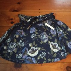 NWT Medium Lauren Conrad Floral Skirt NWT. Received as a gift and does not fit unfortunately.  Selling matching top separately.  Bundle to save.  No trades, please.  LC Lauren Conrad Skirts