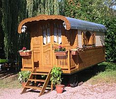 Vintage Gypsy trailer in France.  Repinned by www.mygrowingtraditions.com