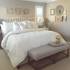 master bedroom - love the bedding and the bench at the end of the bed