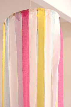 Crepe Paper Chandelier Hang with small hoop on top and larger on bottom to create tree/tube