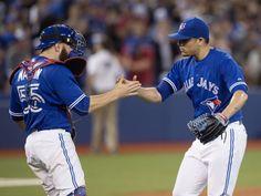 Toronto Blue Jays catcher Russell Martin & pitcher Roberto Osuna celebrate a win
