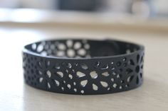 This handcrafted unisex bracelet is made from 100% recycled inner tube. Small daisies align this piece with surrounding dots. Paired perfectly with any outfit.  Small: 6.5 inches (16.5 cm) Med: 7 inches (17.5cm) Large: 7.5 inches (19 cm) Ex-large: 8 inches (20 cm)  .5 inches in width  *Raindrops bracelet sold separately. Beaded bracelet shown to compliment.