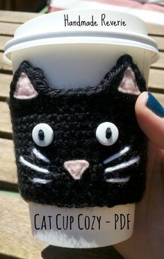 Crochet Black Cat Cup Sleeve coffee Cozy by Jenniface on Etsy Crochet Coffee Cozy, Crochet Cozy, Crochet Gifts, Coffee Cup Cozy, Coffee Cozy Pattern, Gato Crochet, Cup Sleeve, Crochet Kitchen, Crochet Accessories