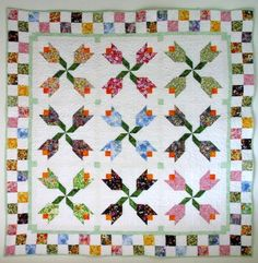 Looking for quilting project inspiration? Check out Spring Fling - Scrappy Spring Tulips by member CarterQuilter. - via @Craftsy