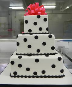 Top off your white wedding cake with a colorful topper! #carlosbakery