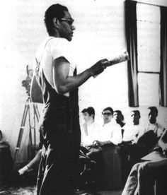 Bob Moses instructs young volunteers for the Freedom Summer, alerting them to the dangers faced in voter-registration campaigns.  © Schomberg Center for Research in Black Culture, New York Public Library