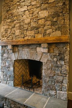 Gorgeous outdoor fireplace in a screened in living room. Love the herringbone brick and farmhouse style mantle.