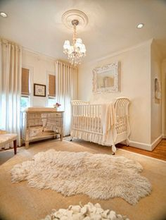 ABSOLUTELY FABULOUS!!!...let's see, animal rug on top of natural rug on top of hardwood for starters, elegant crib, mirrored dresser and chandelier and the combination of elegant sheer panels with natural shades...just about everything!