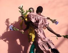 Alek Wek & Grace Bol. All clothes Andreas Kronthaler for Vivienne Westwood, waist-high boots VETEMENTS × Manolo Blahnik