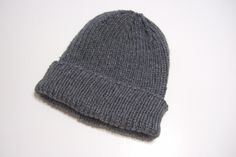 """""""This is a very basic ribbed hat with tailored crown. Directions are given for nine sizes. This pattern is written to be made knitted flat and seamed."""" hat pattern free straight needles Favorite Ribbed Hat for Straight Needles Beanie Knitting Patterns Free, Beanie Pattern Free, Baby Hat Patterns, Mittens Pattern, Knit Patterns, Free Knitting, Free Pattern, Knitting Machine, Knitting Needles"""