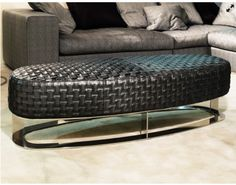 Britto Charette loves the sleek lines of this Italian leather upholstered ottoman.